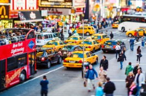 New York City, United States - May 10, 2012: Large group of taxis on 7th Avenue at Times Square in rush hour. Vast number of vehicles hit the streets and avenues of Manhattan every day. Almost half of cars are yellow taxis (well recognized city icon). Taxis are operated by private companies, licensed by the NYC Taxi Commission.